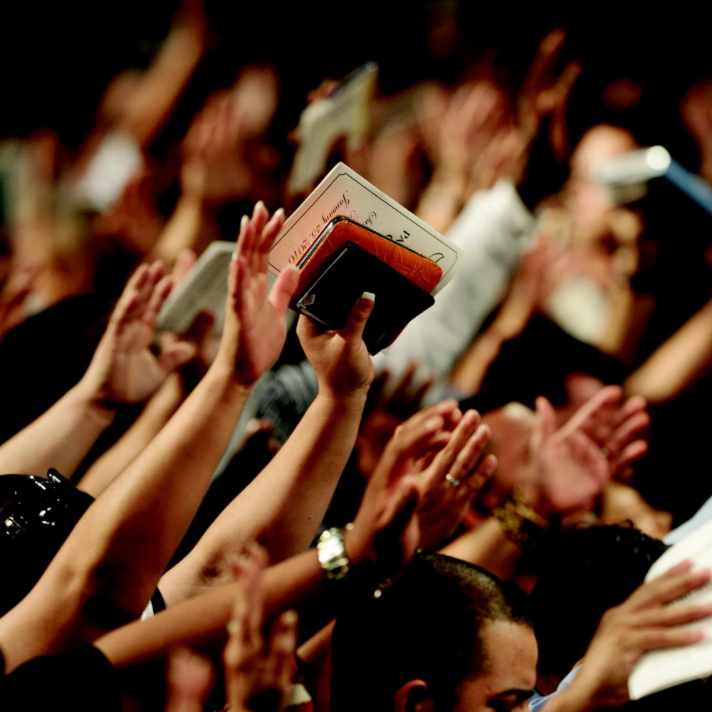 People with hands up in worship